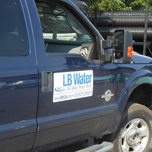 Close-up of passenger door displaying LB water logo on truck